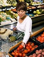 woman choosing veg in a supermarket