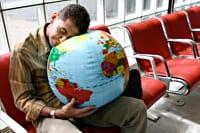 a man asleep at the airport