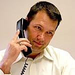 A picture of a man on a cordless phone