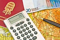 Calculator and euros on map