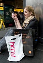 Girl with Orange bag outside HMV