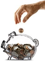 Transparent piggy bank with money being dropped in