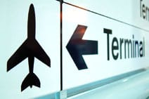 Airport sign directing travellers to the terminal.