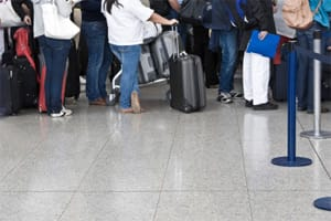Travellers queueing