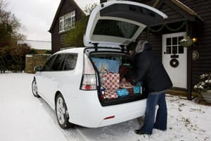 Man loading presents into boot of a car