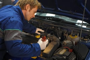 Car mechanic working on car engine