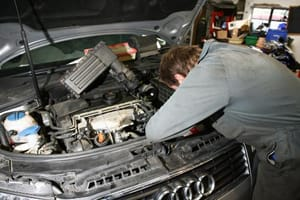 Mechanic servicing an Audi
