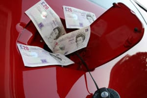 Fuel cap with £20 notes coming out