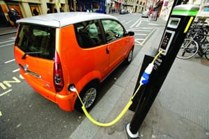 Electric car charging at plug-in charge point