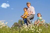 man on bike and kids