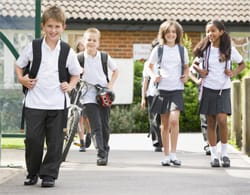 Children in school uniform going back to school
