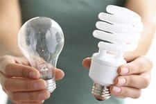 Traditional light bulb versus an energy-saving light bulb
