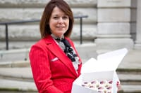 Jenny delivering cupcakes to Mark Hoban
