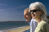 Older couple looking at beach