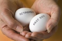 Hands holding two eggs labelled 'retirement' and 'nest egg'