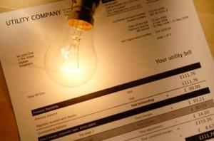 Energy bill with light bulb on top