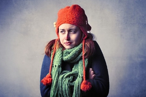 Female wrapped in jumper and scarf