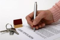 A mortgage deed being signed