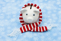 Piggy bank wrapped in a winter scarf