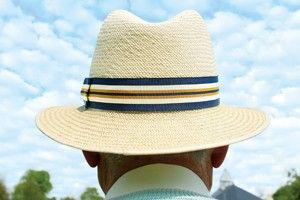 Man wearing a hat staring into the distance