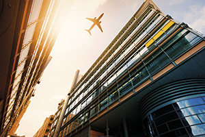 Plane flying over a hotel