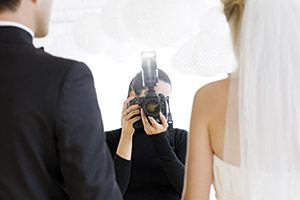 A bridge and groom being photographed