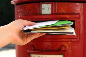 Letters being posted through a postbox