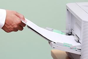 Man using inkjet printer