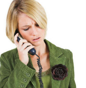 Concerned woman using a telephone