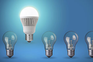LED light bulb amongst regular light bulbs