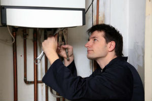 Man fixing his boiler