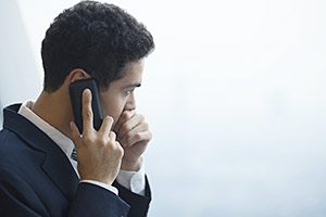 Concerned man speaking on his mobile phone