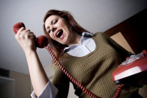 Woman shouting into a phone handset
