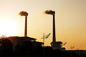 Power station chimneys at sunset
