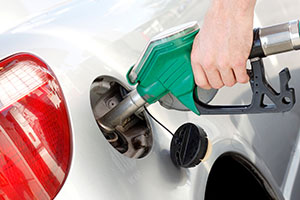 Person filling fuel tank up with petrol