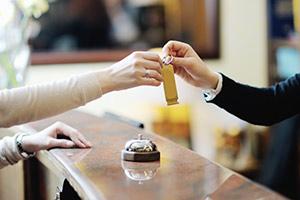 Woman recieving hotel room key