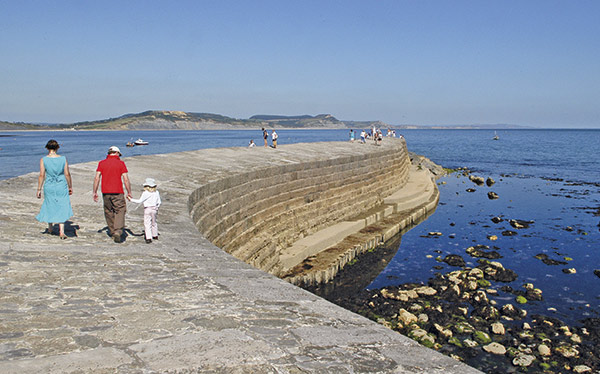 Walking on the iconic Cobb at Lyme Regis