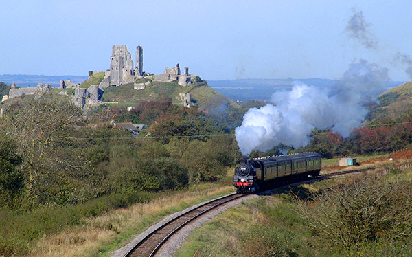 A train on the Swanage Railway passes Corfe Castle