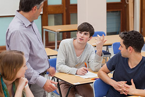 Teacher and student in conversation over A-levels