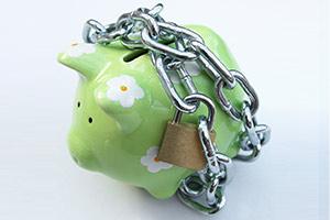 Piggy bank with padlock, savings safety