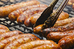 Sausages being cooked on a barbecue
