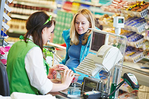 Woman and supermarket cashier