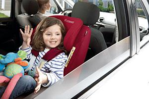 Girl in Maxi-Cosi car seat