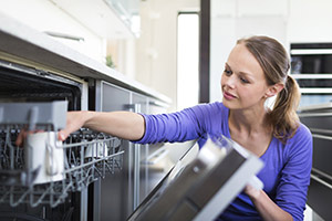 Woman looking into dishwasher
