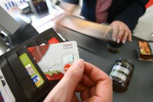 Tesco credit card being pulled out of wallet