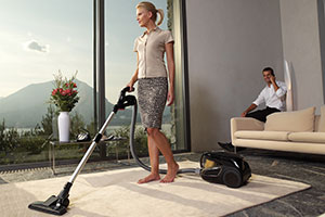 Woman vacuum cleaning
