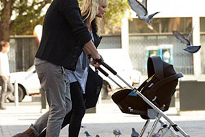Parents pushing a Mamas & Papas Urbo pushchair
