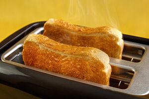 Toaster toasting toast