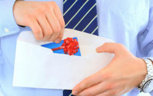 Man pulling gift from Clydesdale and Yorkshire Bank out of envelope