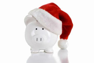 White piggy bank wearing a red Christmas hat